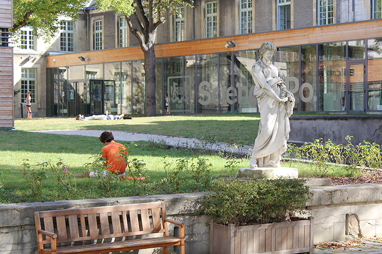 Students studying outside of a building on the Reims campus. Photo credit: Sciences Po