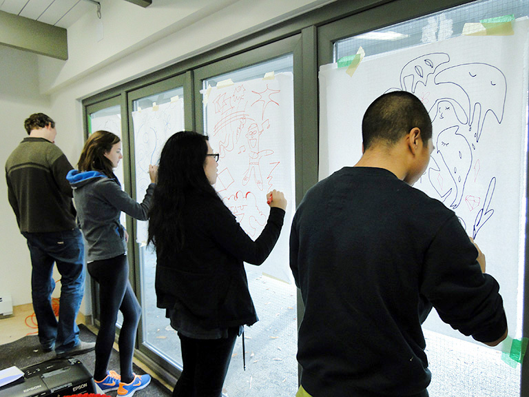 UBC students and community partners work on illustrations to capture stories connected to INTERactive. Photo credit: Collingwood Neighbourhood House