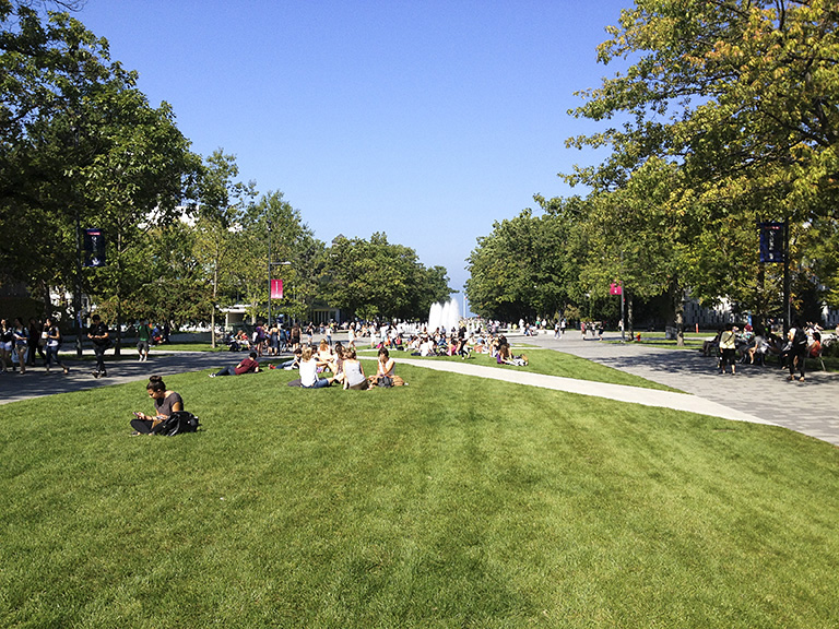 Students enjoy the sunshine and green space on Main Mall. Photo credit: Dean Gregory