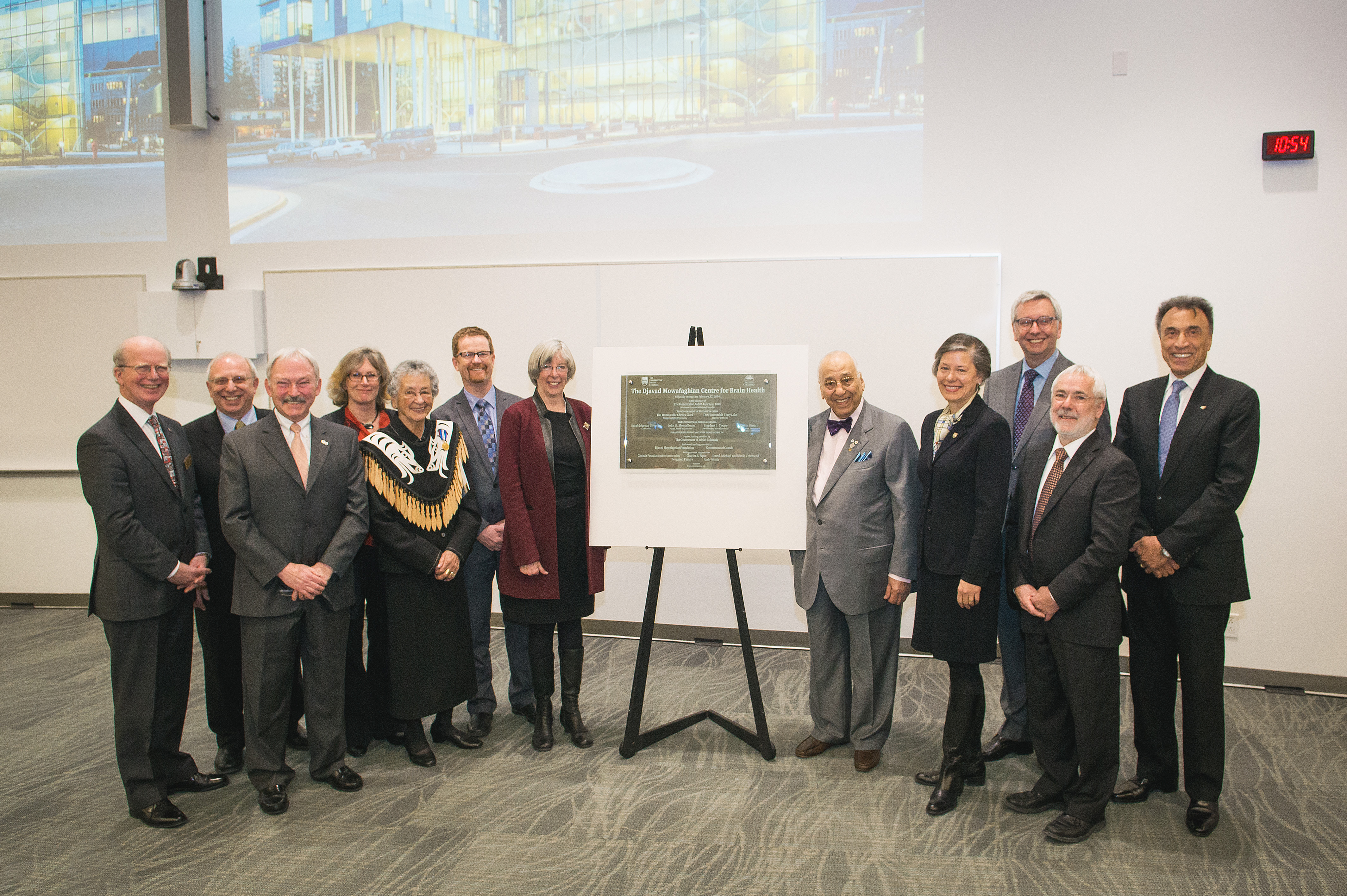 At the official opening of the Djavad Mowafaghian Centre for Brain Health. From left: Dr. Gavin Stuart, Dean and Vice Provost Health; Dr. David Ostrow, President and Chief Executive Officer, Vancouver Coastal Health; Max Cynader, director, Brain Research Centre and DMCBH; Marilyn Lenzen, MS patient; Mary Charles, Musqueam Elder; Terry Lake, B.C. Minister of Health; The Honourable Judith Guichon, Lieutenant Governor of B.C.; Djavad Mowafaghian; UBC Chancellor Sarah Morgan-Silvester; UBC President Stephen Toope; Robert Davidson, Vice-President of Programs and Planning at the Canada Foundation for Innovation; Hamid Eshghi, President of the Djavad Mowafaghian Foundation. Photo: Martin Dee